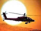 helicopter over sunset